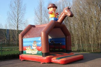 Big bouncy castle Cowboy with roof